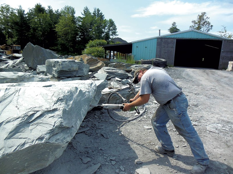 A Camara company worker jackhammering a block of slate at the Blissville quarry. - KEVIN J. KELLEY