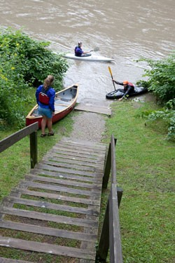 A few paddlers prepare to take out during high water.