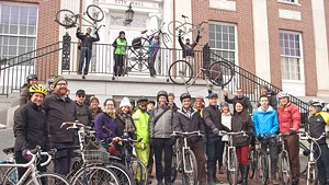 A group of cyclists in front of Burlington City Hall before a ride celebrating Budnitz Bicycles and Modern Mobility Movement Day
