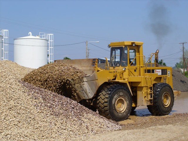 A loader collects gravel in Burlington - MIKE IVES