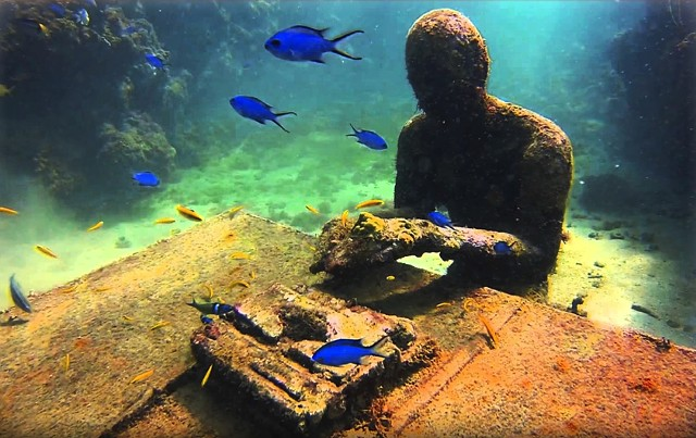 A mysterious underwater typist in Angel Azul, screening at the Brattleboro Film Festival. - COURTESY BRATTLEBORO FILM FESTIVAL