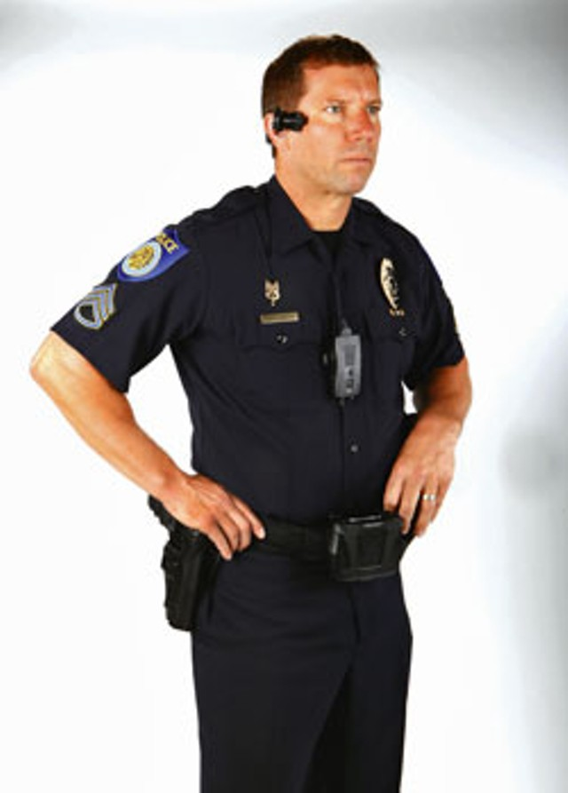 A police officer wearing an AXON Video Recorder