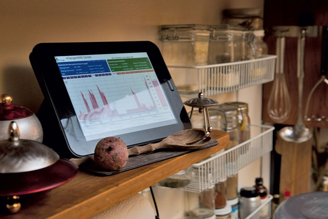 A tablet monitors electricity usage - MATTHEW THORSEN