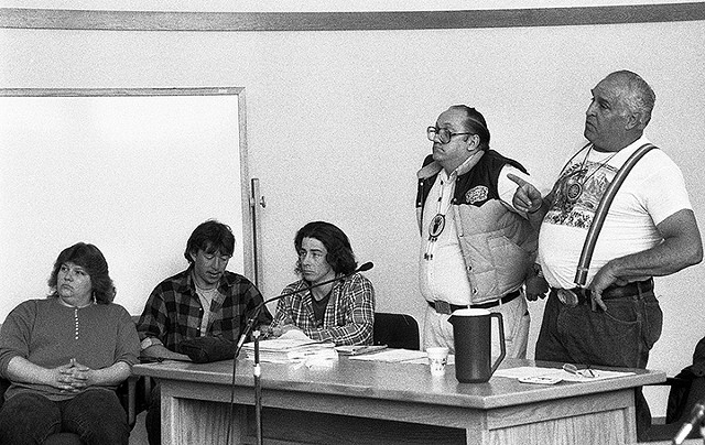 """Abenaki Chief Homer St. Francis (right), points finger at the judge who presided over court cases against Abenaki for their refusal to recognize the state of Vermont or the U.S. The judge told St. Francis that he was out of order and the chief replied, """"No judge, you're out of order."""" (1991) - PHOTO COURTESY OF ORIN LANGELLE"""