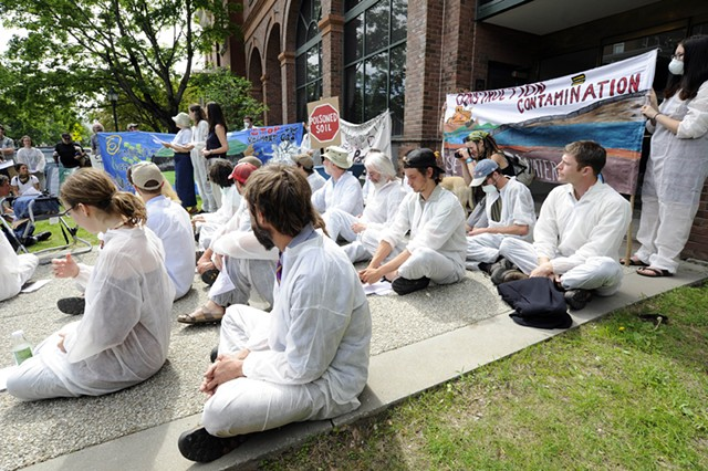 Activists outside the Public Service Department in Montpelier on Monday - JEB WALLACE-BRODEUR