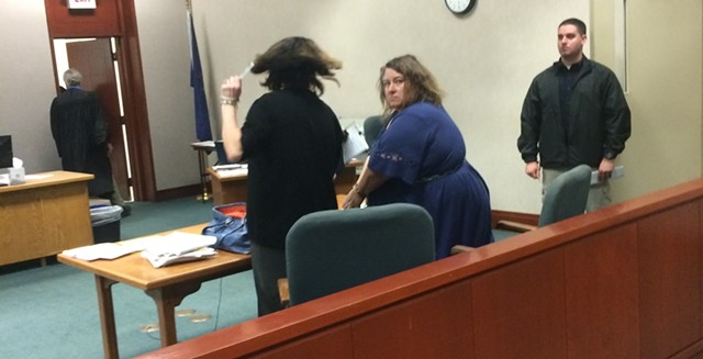 Alleged embezzler Lisa Peduzzi looks back during her arraignment in Chittenden Superior Court. - MARK DAVIS