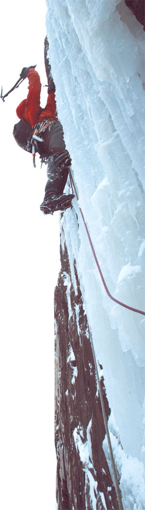 An ice climber on the cliffs of Mt. Pisgah - ALDEN PELLETT