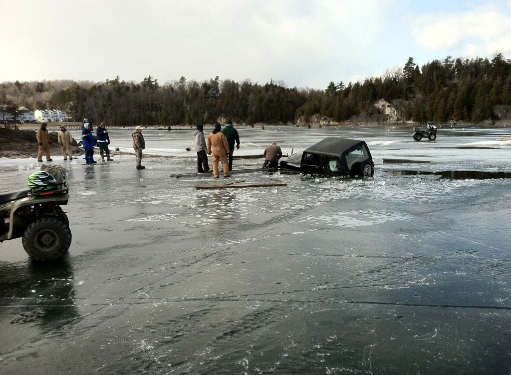 An unidentified driver attempts to pull his jeep out of the ice in Malletts Bay in February 2012 - KEN PICARD