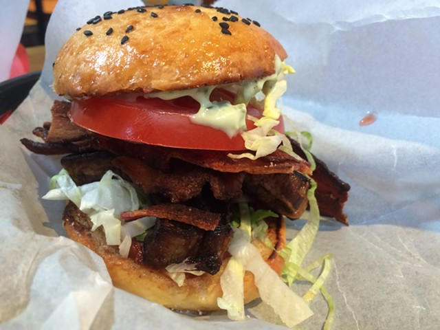 ArtsRiot's burger is a serious affair, but it's not gratuitously large. - ALICE LEVITT