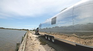 At 34 feet long, this airstream, completed in May, is used as a guest house for visiting family and features solid red oak furnishings