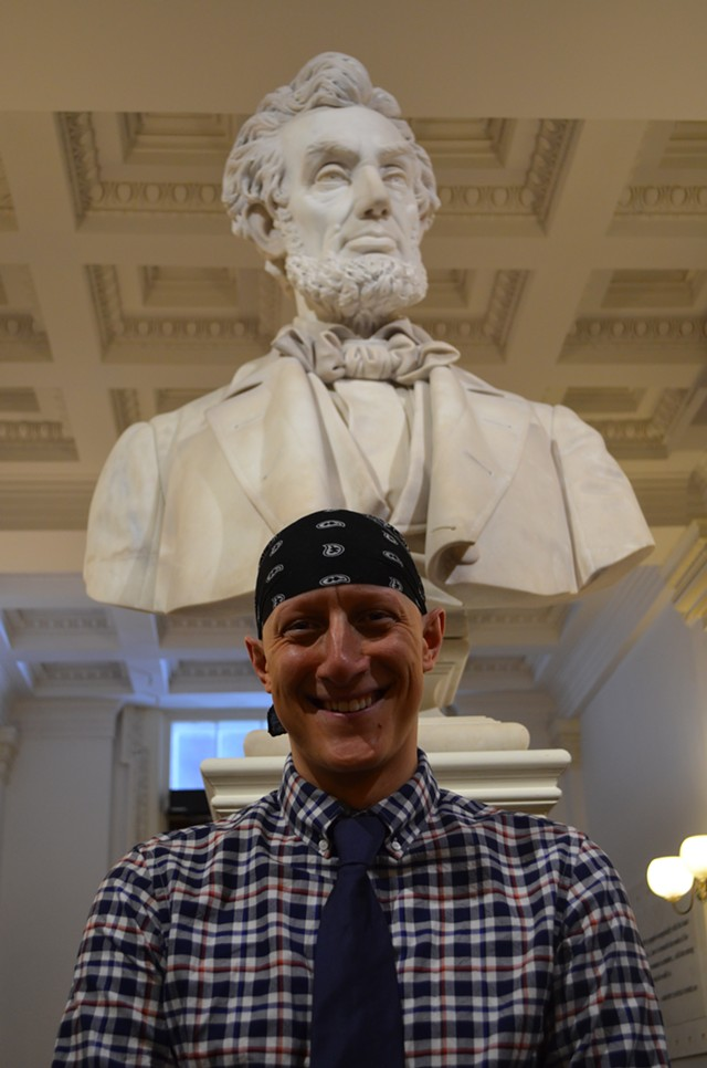 Ben Sarle stands in front of a statue of Abraham Lincoln at the Statehouse Tuesday. - PAUL HEINTZ