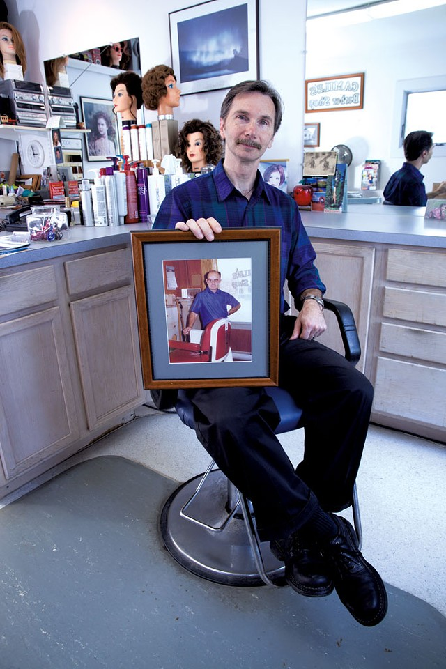 Bernie Dubois holds a photo of his father, Camile Dubois - MATTHEW THORSEN