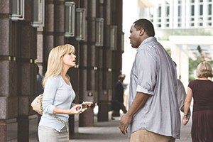 BLOND AMBITION Bullock pep talks her gigantic protégé in Hancock's fact-based sports drama.