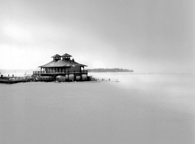 """""""Boathouse in Winter"""" by Hing A. Kur, The Art of Lake Champlain"""