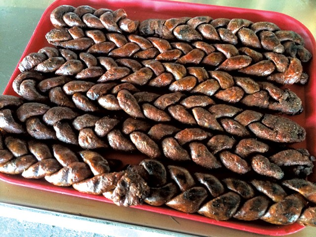Braided merguez waiting to be smoked - ALICE LEVITT