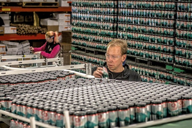 Brewmaster Dave Hartmann among the cans - PHOTOS COURTESY OF  LONG TRAIL BREWING CO.
