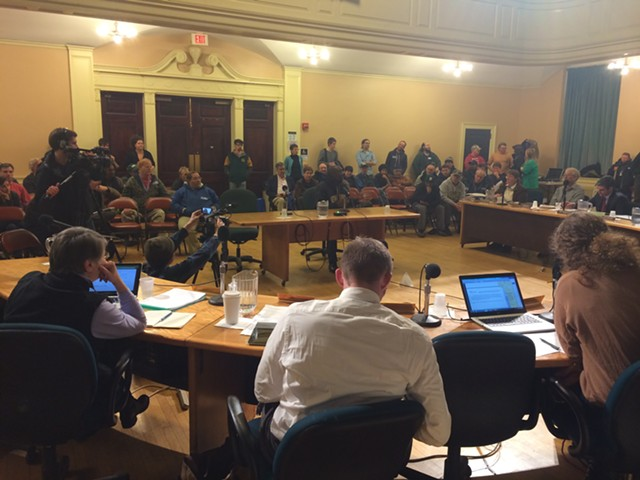 Burlington city councilors face a packed crowd of CCTA drivers and supporters while debating a resolution urging the drivers and management to settle their differences in binding arbitration. - MARK DAVIS