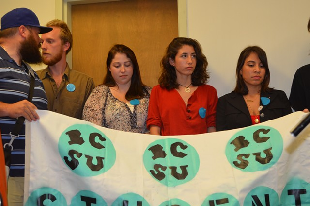 Burlington College students hold a banner at Tuesday's press conference. - ALICIA FREESE