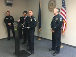 Burlington Police Chief Michael Schirling, with Burlington Mayor Miro Weinberger in the background, announces his retirement. - MARK DAVIS
