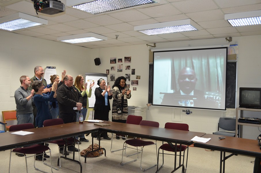 School board members and members of the search committee congratulate Yaw Obeng on Skype. - ALICIA FREESE