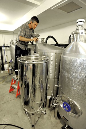Checking the fermenting tanks - JEB WALLACE-BRODEUR