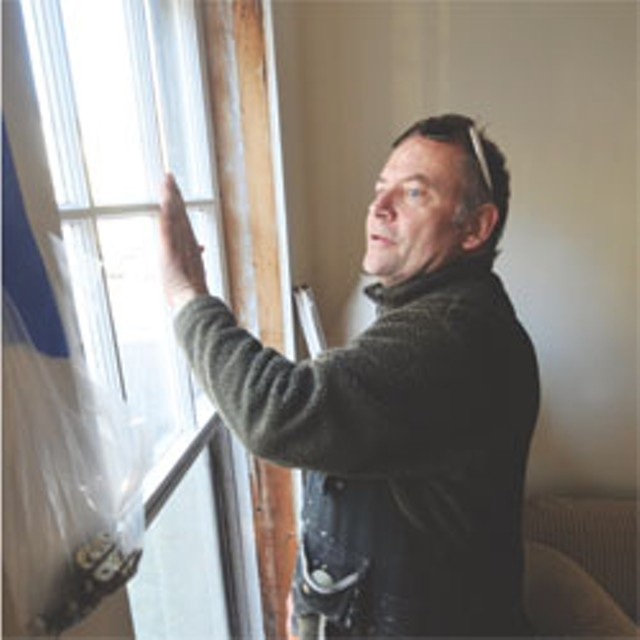 Chris Pratt of Open Sash installs retrofitted energy-efficient windows in a Montpelier home - JEB WALLACE-BRODEUR
