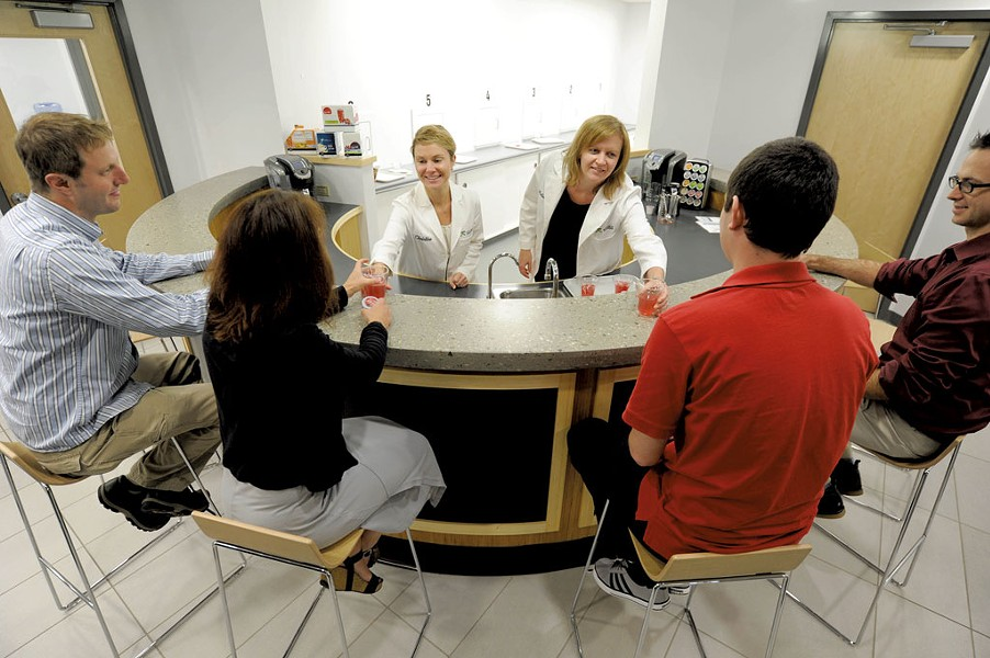 Christine Thompson, left, and Melissa Gorham offer samples to tasters - JEB WALLACE-BRODEUR