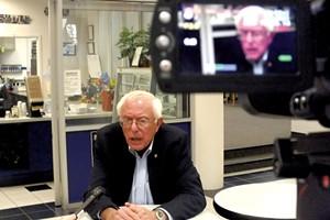 CNN interviews Sanders at a town hall meeting in Dubuque, Iowa - ADAM BURKE