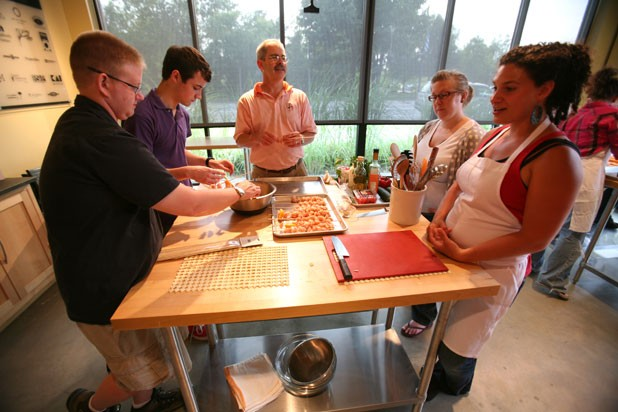 Corey Perry and Wyatt Peck help fix a salad during a class at Healthy Living - JEB WALLACE-BRODEUR