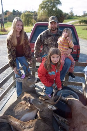 MATTHEW THORSEN - David Laurin with daughters Brittany, Macie and Katie