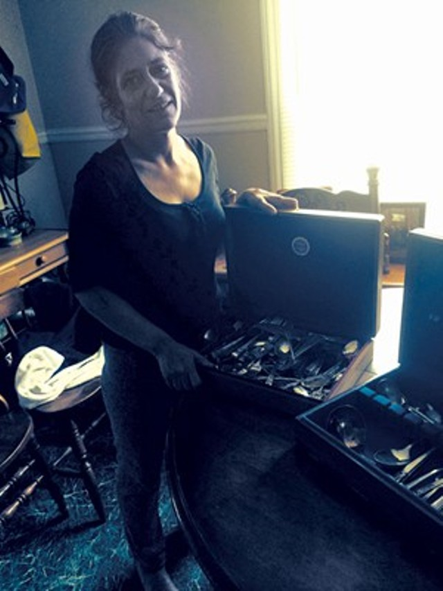 Deirdre Hey posed with family silverware that was confiscated by police during  a raid in March. Hey was arrested by federal agents on new charges days after a profile of her appeared in Seven Days. - MARK DAVIS