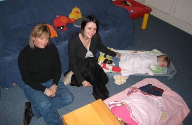 Didi Harris and Tina Boljevac, child care providers at The Greater Burlington YMCA - MIKE IVES