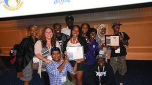 Diversity Rocks members display their ECCO awards.