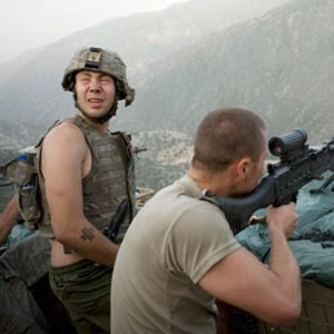 DOOM WITH A VIEW U.S. soldiers scout a landscape as deadly as it is beautiful in Hetherington and Junger's documentary.