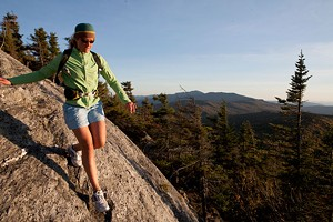 Emily Johnson navigates a large slab of granite high up in Vermont's Worcester Mountain area.