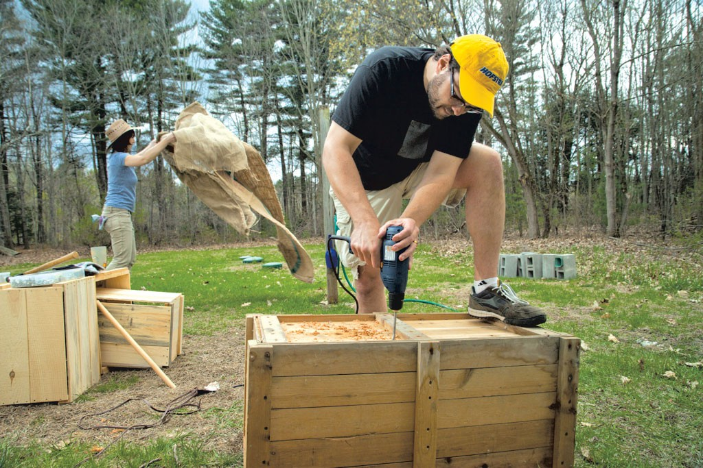 Ethan and Laura modifying crates for their garden - MATTHEW THORSEN