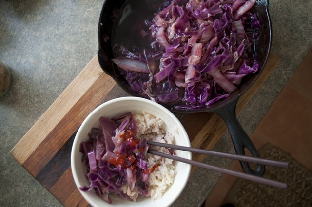 Cider-braised cabbage, served with rice and Sriracha - HANNAH PALMER EGAN