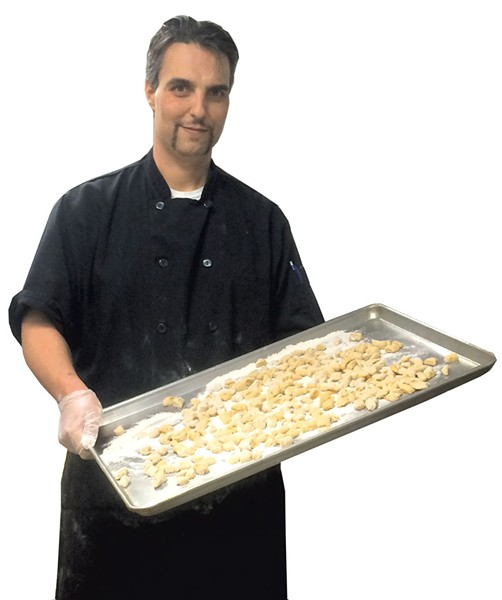 Franco Checchi with a tray of gnocchi at Junior's Rustico - ALICE LEVITT