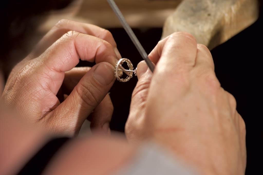 Frank assembling a chandelier earring - MATTHEW THORSEN