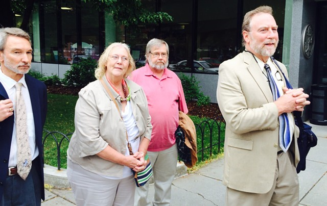 From left, Allen Gilbert, director of the Vermont chapter of the ACLU; Rhonda Taylor, her husband, Ken Taylor and attorney Robert Appel announce outside U.S. District Court in Burlington the filing of a  wrongful death lawsuit against the Vermont State Police for the 2012 death of Rhonda Taylor's son, MacAdam Mason. - MARK DAVIS