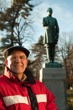 Gary De Carolis in front of General George Stannard's grave at Lakeview Cemetery - MATTHEW THORSEN
