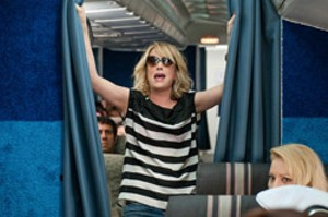 GIRLS GONE WILD Wiig's character starts the bachelorette party early on a plane to Vegas.