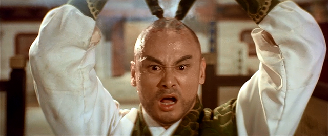 Gordon Liu using giant incense sticks to give himself the mark of a monk in Eight Diagram Pole Fighter - SHAW BROTHERS