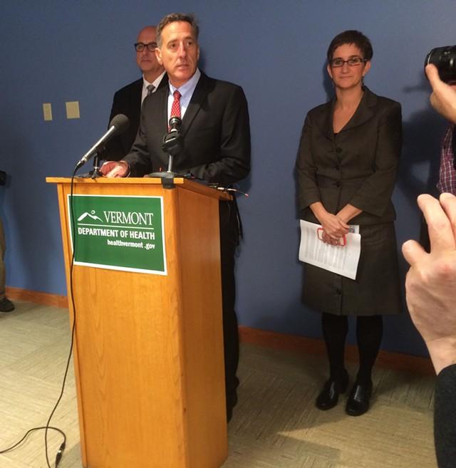 Gov. Peter Shumlin at a press conference, acting Health Commissioner Tracy Dolan at back - MARK DAVIS