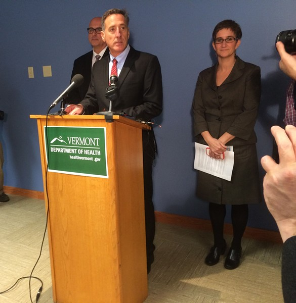 Gov. Peter Shumlin at a press conference, acting Health Commissioner Tracy Dolan at back - MARK DAVIS
