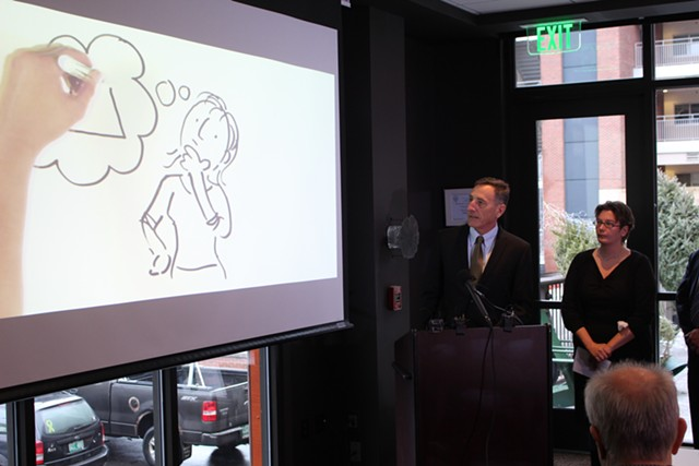 Gov. Peter Shumlin screens a new health care reform ad Wednesday at Hotel Vermont. - PAUL HEINTZ
