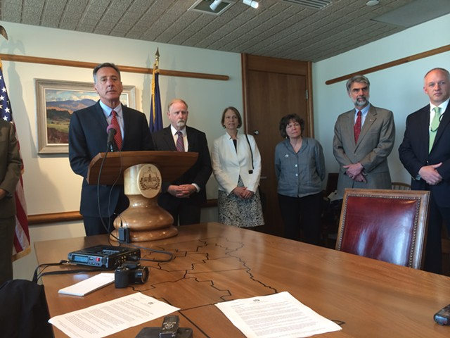 Gov. Peter Shumlin, with DCF Commissioner Dave Yacovone at his left, announces a series of reforms to the agency in response to two recent child deaths. - MARK DAVIS