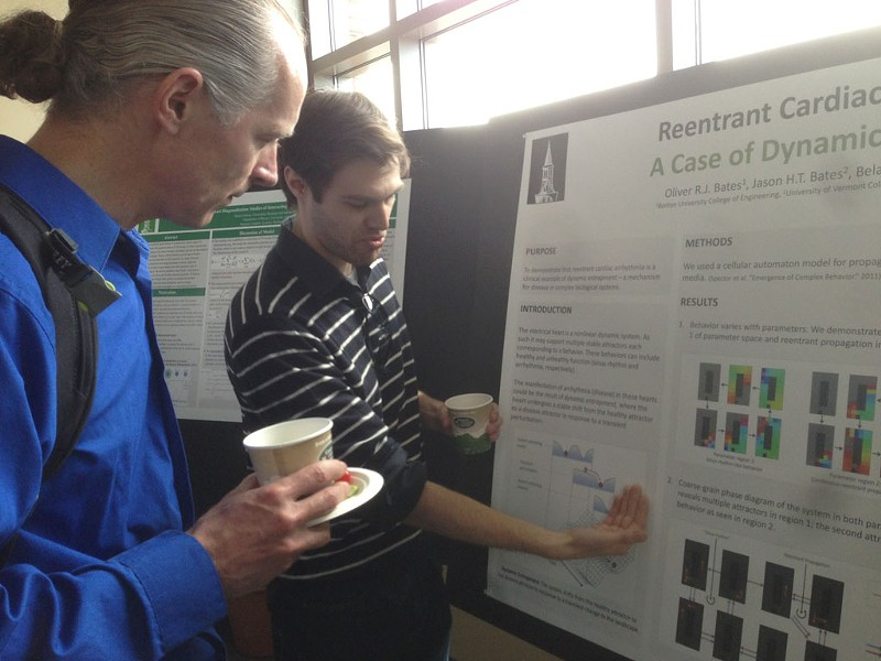 Grad student Oliver Bates explains his research to entrepreneur Uwe Heiss - COURTESY OF CATHY RESMER