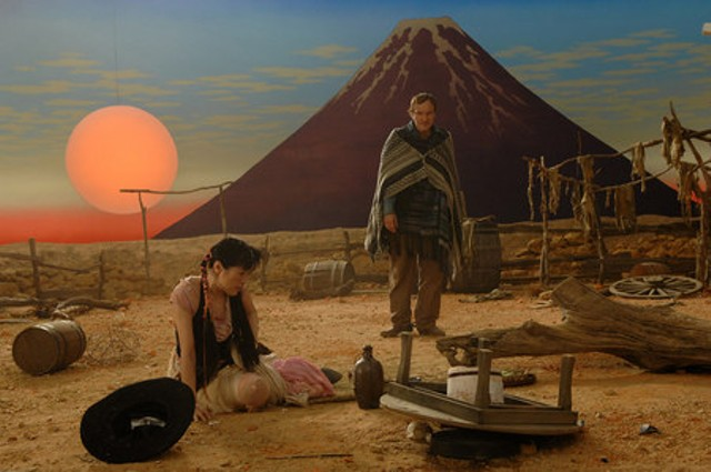 Gunslinger Tarantino in the deliberately stagy-looking opening scene of Sukiyaki Western Django - FIRST LOOK INTERNATIONAL