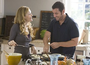 HALF-BAKED Sandler and Mann have an extraneous romance in Apatow's very long comedy.